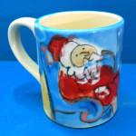 Santa by the Fireplace Mug by Sue Bolt
