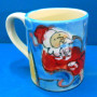 Santa by the Fireplace Mug by Sue Bolt